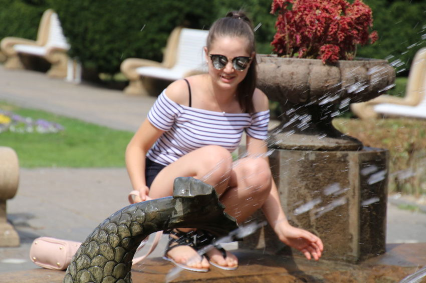 EyeEm Selects Sunglasses Water Young Adult Lifestyles Business Finance And Industry Adult People One Person Outdoors Day Adults Only Sitting Eyeglasses  Drinking Fountain Young Women Spraying Full Length One Young Woman Only Smiling One Woman Only