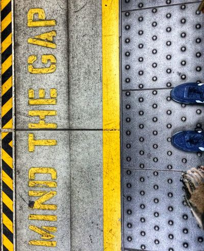 -- Mind the Gap -- Close-up Feet On The Ground From My Point Of View From Where I Stand Heathrow Express London London Calling London Lifestyle London Streets London Underground London United Kingdom Mind The Gap Mindthegap No People Platform Punchy Scarf Street Signs Streets Of London Train Station Train Station Platform Trainers Underground United Kingdom