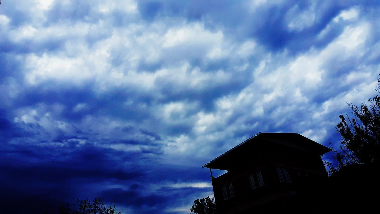 cloud - sky, sky, low angle view, silhouette, weather, house, built structure, building exterior, no people, outdoors, day, nature, architecture, beauty in nature