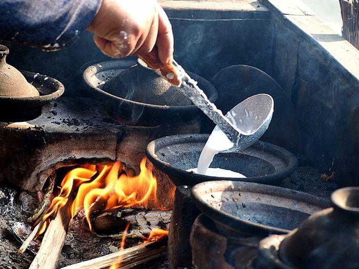 Cropped Image Of Man Preparing Pancake In Stove