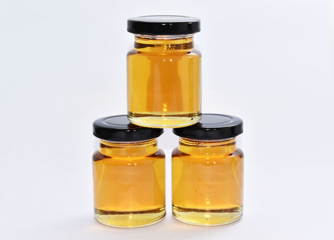 Honey in jar, isolated white background Honey Bees  Remedy Close-up Glass - Material Golden Honey Buzz Buzz Honey Bee Honey Jar Natural Honey Natural Honey No People Studio Shot White Background