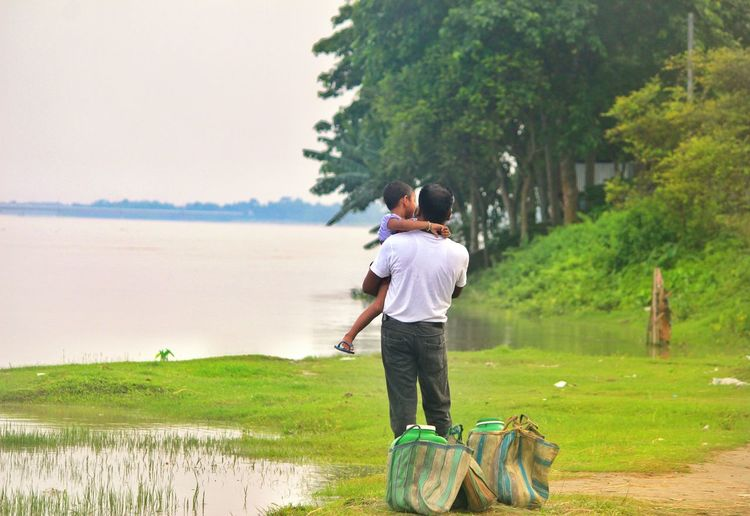 Live For The Story Full Length Leisure Activity Water Outdoors Day Lifestyles Rural Scene Standing WestBengal Coochbehar Green Color Beauty In Nature Cityofbeauty Streetphotography EyeEmNewHere