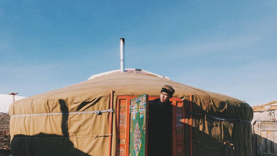 View Of Man In Doorway Of Yurt