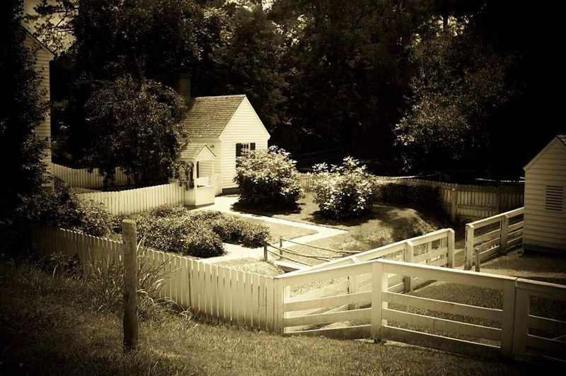 A Williamsburg Backyard. Williamsburg Williamsburg, VA Colonial Williamsburg House Colonial Williamsburg Revolutionary War Period Architecture American Colonial Home 1700's House Sepia Photography Sepia_collection Historical Site Historical Landmarks Historicalplaces