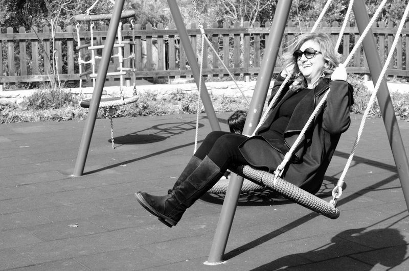 Woman on swing at playground