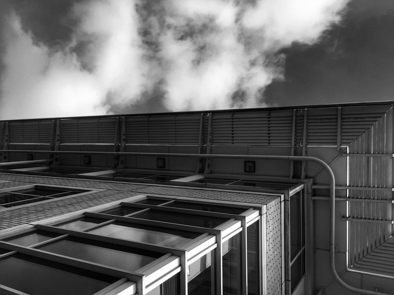Architecture B&W. Low Angle View Sky Architecture Cloud - Sky Built Structure Cloud Cloudy Building Exterior Repetition Modern Office Building Day Skyscraper High Section Tall - High Exterior City Life Tall Façade Architectural Feature EyeEm Masterclass Black & White EyeEm Gallery Getty X EyeEm Architecture