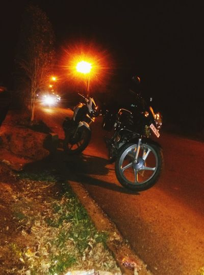 My photos Transportation Illuminated Mode Of Transport Night Land Vehicle Bicycle Road Street Motorcycle Parking Stationary Glowing Lens Flare Outdoors Dark Parked Adventure Journey Cycle First Eyeem Photo