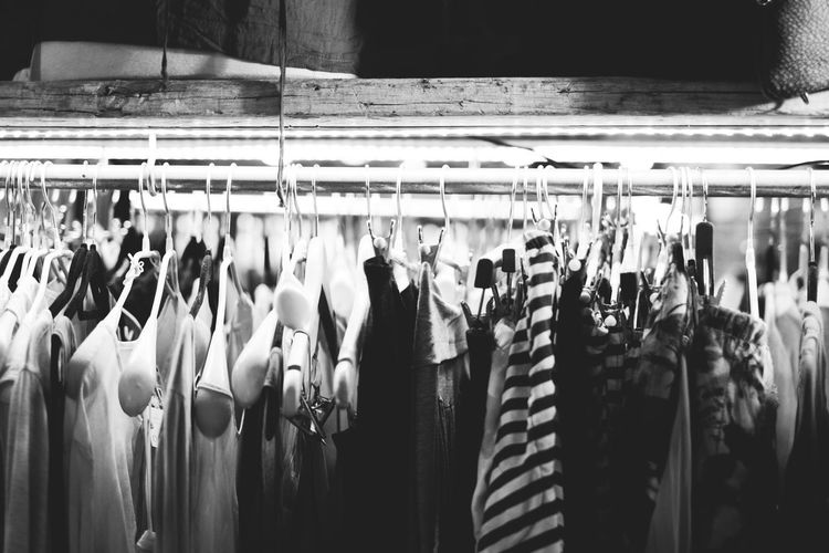 Blackandwhite Choice Close-up Clothing Clothing Store Coathanger Day Fashion Hanging Illuminated In A Row Indoors  Large Group Of Objects No People Panoramic Retail  Shopping Variation The Street Photographer - 2017 EyeEm Awards
