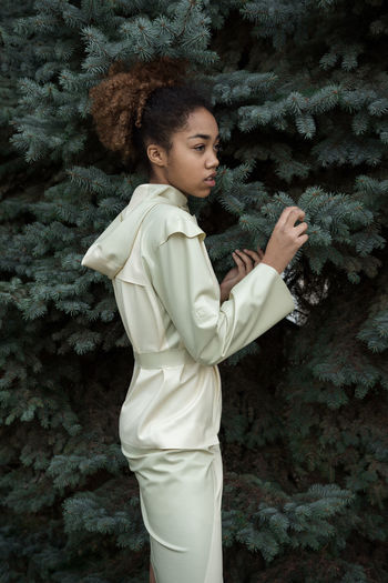 Hiding Game White Dress Latex Dress  Raincoat Bushes Branches Pines Evergreen Dark Skin Black Hair Afrohair Model Girl Linas Was Here