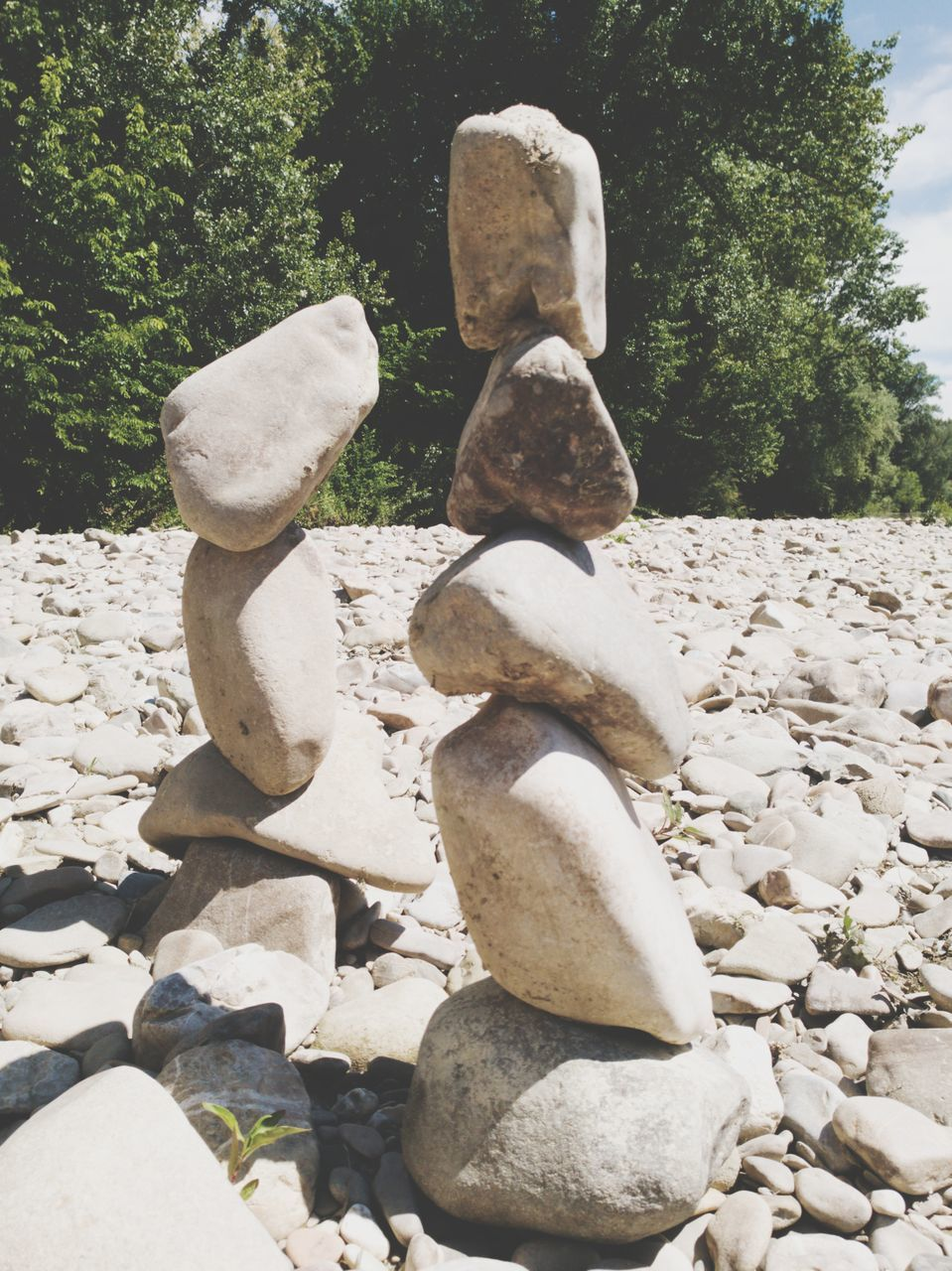 stone - object, rock - object, pebble, tree, day, no people, nature, outdoors, stack, tranquility, statue, beauty in nature, close-up, sky