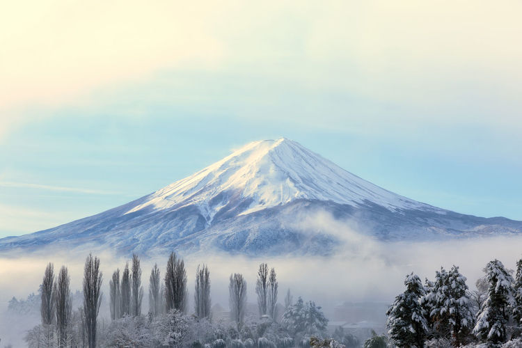 Japan Beauty In Nature Cloud - Sky Cold Temperature Environment Fuji Idyllic Mountain Mountain Peak Nature No People Non-urban Scene Power In Nature Scenics - Nature Sky Snow Snowcapped Mountain Tranquil Scene Tranquility Tree Volcanic Crater Volcano Winter
