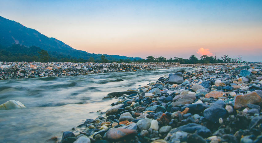 Beauty In Nature Clear Sky Day Motion Mountain Nature No People Outdoors Pebble River River Side Rock - Object Rocks Rocks And Water Scenics Sky Skyscraper Sunset Sunset #sun #clouds #skylovers #sky #nature #beautifulinnature #naturalbeauty #photography #landscape Water Be. Ready.