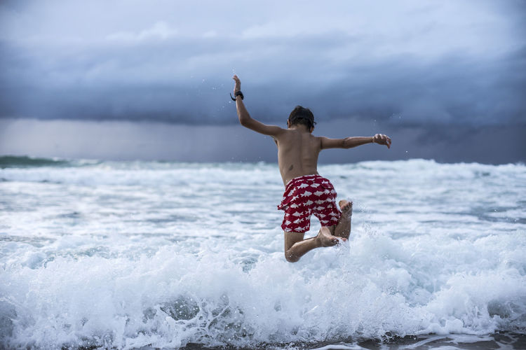 Playing with the waves Phuket Thailand Beauty In Nature Cloud - Sky Day Horizon Over Water Kid Leisure Activity Lifestyles Motion Nature One Person Outdoors People Real People Sea Shirtless Sky Storm Cloud Water Wave