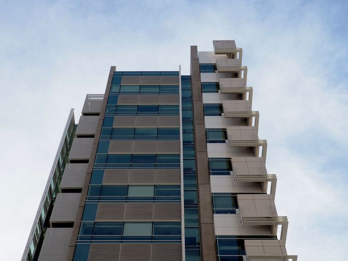 Sky Low Angle View Built Structure Architecture Cloud - Sky Nature Building Exterior No People City Day Building Modern Office Outdoors Office Building Exterior Tall - High Window Glass - Material Pattern Business Skyscraper Apartment