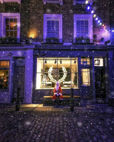 Santa Claus in London Night Full Length One Person Street Mid Adult Building Exterior People Outdoors Real People Illuminated Front View Sidewalk Sitting Adult Lifestyles Built Structure Architecture Cold Temperature City Adults Only Father Christmas Santa Claus Santa Christmas Snow