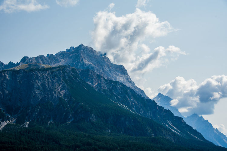 The peaks of the dolomites covered by clouds around the town of cortina d'ampezzo, belluno, italy