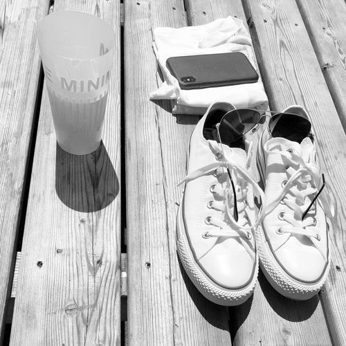 Beer Lifebythelake Blackandwhitephotography Converse Wood - Material Shoe Sunglasses High Angle View Day Glasses Outdoors Still Life Table Absence Security No People Fashion Close-up Sunlight Pair Nature Sandal Flip-flop Plank
