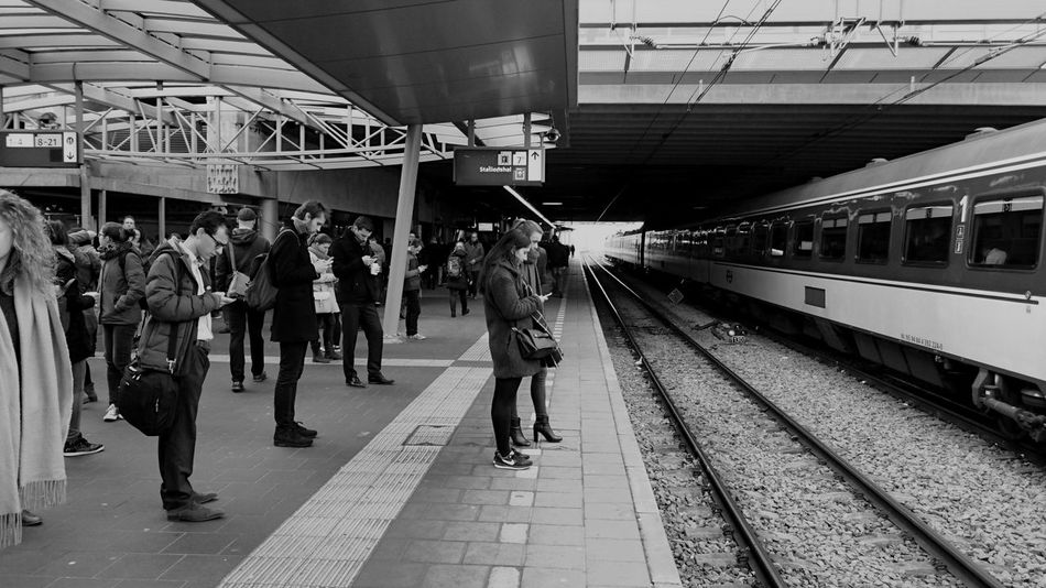 Where is my train? Train Delay Utrecht Centraal (c) 2016 Shangita Bose All Rights Reserved Where Is The Train? People Photography People Desperate to Get To Work On Time Checking their Mobile Phone for The Next Available Train The Architect - 2016 EyeEm Awards The Street Photographer - 2016 EyeEm Awards The Portraitist - 2016 EyeEm Awards My Commute Need For Speed Feel The Journey On The Way Snap A Stranger