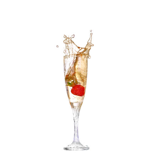 Close-up of wine glass against white background