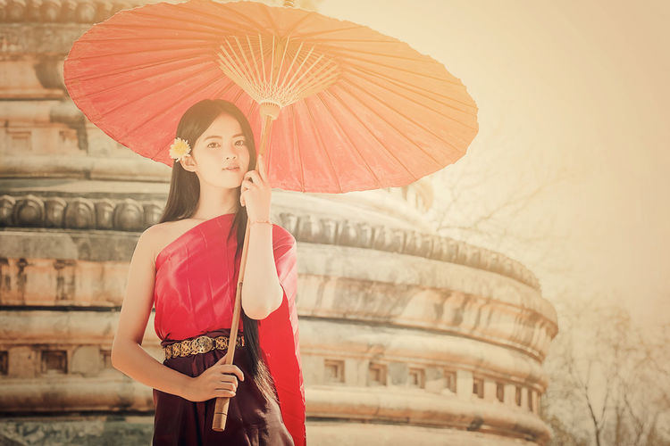 Thai traditional dress Thai Tradition Dress Lanna Beauty Girl Umbrella One Person Real People Young Women Holding Outdoors Lifestyles Standing Portrait Young Adult Red Day People