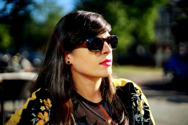 Woman Wearing Sunglasses Standing Outdoors