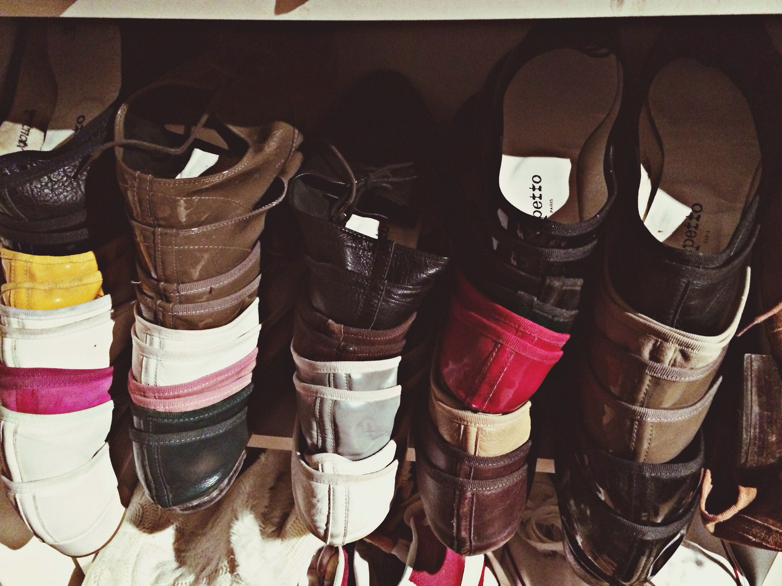indoors, men, shoe, low section, in a row, text, communication, lifestyles, side by side, standing, variation, clothing, person, choice, hanging, high angle view, technology