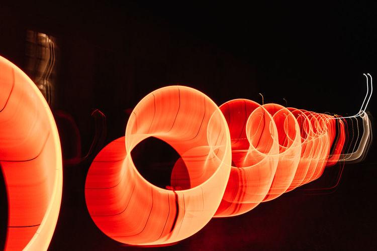 Close-up of illuminated lanterns over black background