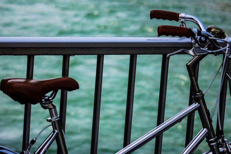 Close-up of bicycle on railing