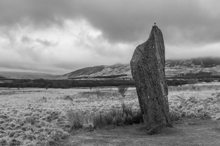 Share Your Adventure A standing stone with bird atop on Machrie Moor on Arran, Scotland. They date from the Bronze Age from around 1800BC to 1600BC. EyeEm_Scotland Scotland Landscape Landscape_photography Blackandwhite EyeEm Best Shots - Black + White Arran  Standing Stones Bird