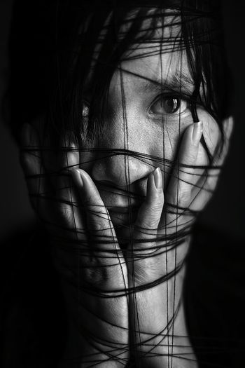 Close-Up Portrait Of Woman Wrapped In String
