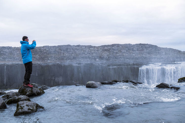Selfoss Waterfall, Iceland Selfoss Iceland Waterfall Water Man Taking Picture Man Taking Photo Take Photo Camera Phone Photography Tourism Tourist Adventure Standing Rock Men Nature