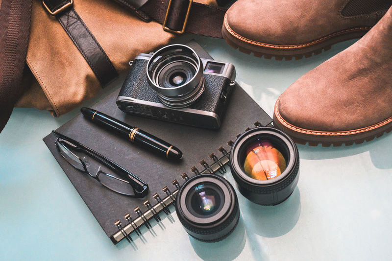 High Angle View Still Life Table Indoors  No People Photography Themes Close-up Equipment Variation Technology Work Tool Arrangement Leather Camera Travel Lenses Shoes Camera Bag Preparation