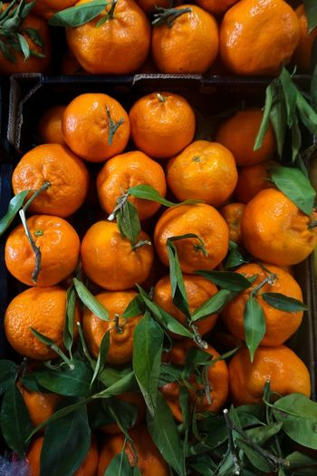 Close-up of oranges for sale at market stall