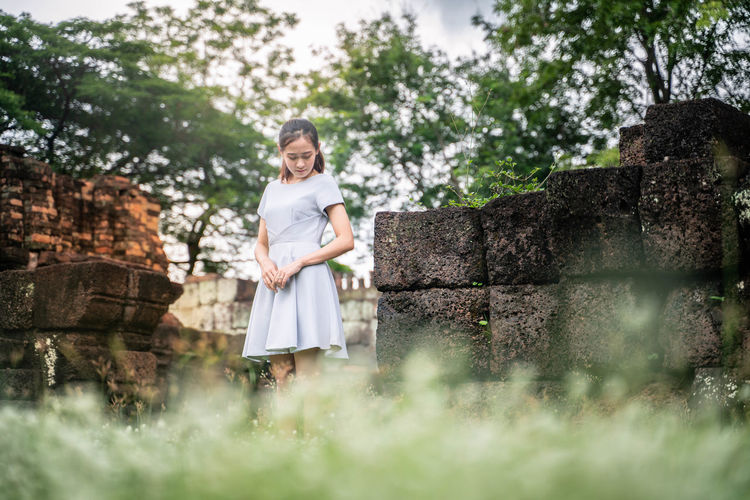 Dress Plant Portrait Fashion One Person Women Front View Looking At Camera Day Smiling Standing Nature Tree Child Young Adult Full Length Emotion Happiness Outdoors Beautiful Woman Hairstyle Innocence