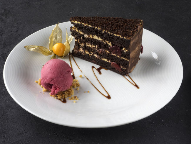 piece of chocolate cake with a ball of crimson ice cream Chocolate Ball Brownie Browny Cake Close-up Crimson Day Dessert Food Food And Drink Freshness Frozen Food High Angle View Ice Cream Indoors  Indulgence No People Piece Plate Ready-to-eat Scoop Shape Serving Size SLICE Sweet Food Temptation