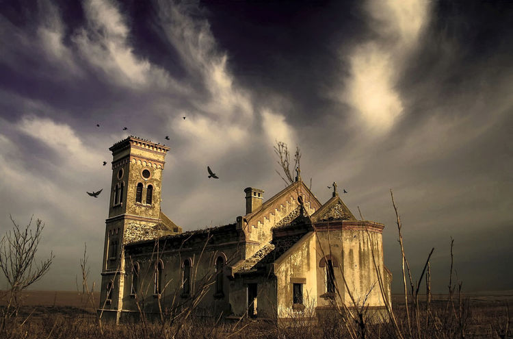 """A Lost And Forgotten Gothic Monastery Culelia, Colilia or Colelia was a village in Dobrogea, now gone, which was located between Cogealac and Gradina. It was founded in 1880 and inhabited until 1940 by Germans, when was carrying the German name of Colelie, Kolelie or Kulelie . Once the Germans were displaced in the Third Reich in 1940, the village remained very sparsely populated. In 1945 Colelia was repopulated with Romanians and Macedonians, who were given land and the existing homes. Roman-Catholic Church, which was built by the Germans in 1934 , returned to the Romanian Orthodox Church. Since there was no dispensary in the village or school, people were forced to leave the town, so in 1966 it remained empty. In 2006, in addition to the church which was left standing, the Holy Monastery of nuns was founded """"Entrance of the Mother of God in the Church"""". Besides the function of monastery, the settlement has as a mission a charitable activity and social, which is to house and support the elderly deprived of opportunities,with no pension and with very small income. Architecture Birds Cathedral Church Church Clouds Colelia Cross Gothic Gothic Architecture Gothic Church Historic History Hounted Hounted House Monastery Old Old Buildings Oldtown Place Of Worship Religion Romania Ruined Building Sky Spirituality"""