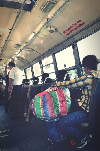 Life must go on Carryon Carry On Move Bangkokbus Vehicle Interior Transportation Mode Of Transport Public Transportation Train - Vehicle Land Vehicle Travel Men Real People Window Rail Transportation Journey Lifestyles People Sitting Bus