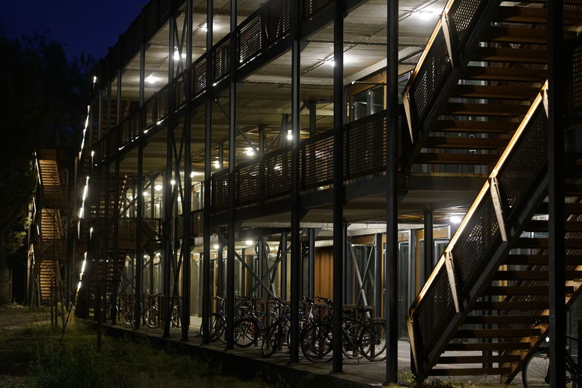 Container Apartment Apartment Building Illuminated Architecture Night Built Structure Lighting Equipment No People Building Exterior Staircase Building Railing Outdoors Transportation Steps And Staircases In A Row Metal City Absence Modern Mode Of Transportation Footpath