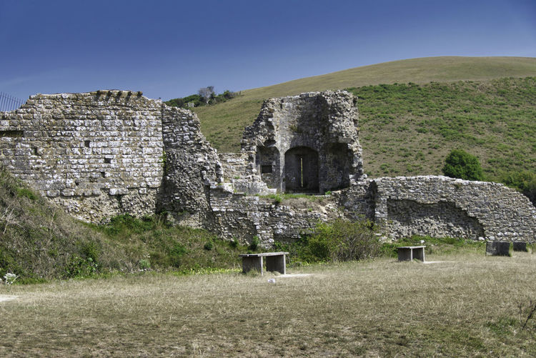 Old ruin building on field against clear sky