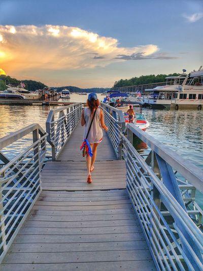 Full length of woman on pier over sea against sky