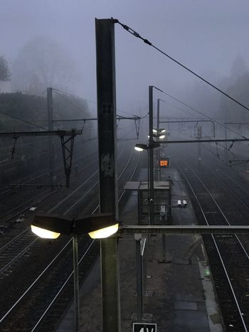 Brouillard Transportation Illuminated Sign Sky No People Architecture City Connection Mode Of Transportation Rail Transportation Electricity  Outdoors