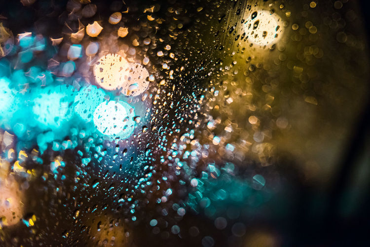 Water Drop Window Wet Glass - Material Close-up Transparent RainDrop Rain Indoors  No People Selective Focus Nature Backgrounds Motor Vehicle Full Frame Mode Of Transportation Car Rainy Season Glass Lens Flare Abstract
