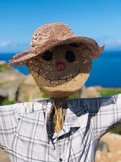 Scarecrow against sky