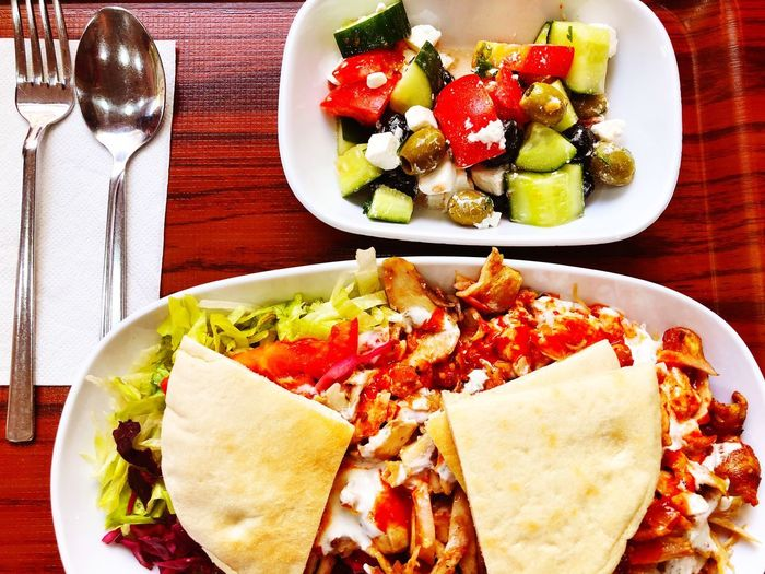 A meal out. Shawarma Dishes Greek Salad Dinner Lunch Meal Tasty Tortilla Salad Food And Drink Food Healthy Eating Freshness Fruit Table Wellbeing Ready-to-eat Plate No People Indulgence Directly Above Meal Serving Size