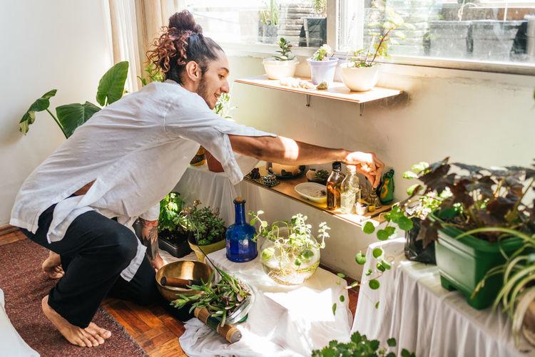 Full length of aromatherapist gardening home
