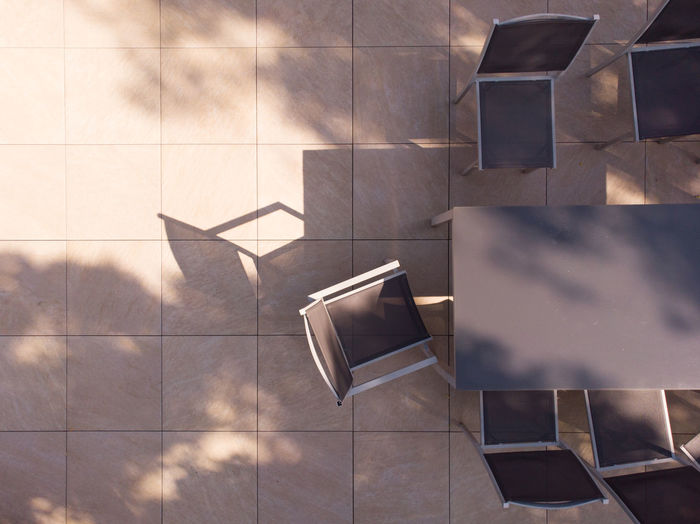 High angle view of chairs on tiled floor