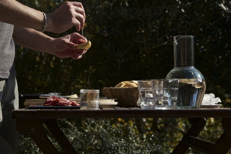 Barbecue Bread Day Drinking Glass Food And Drink Human Body Part One Person Outdoors Table
