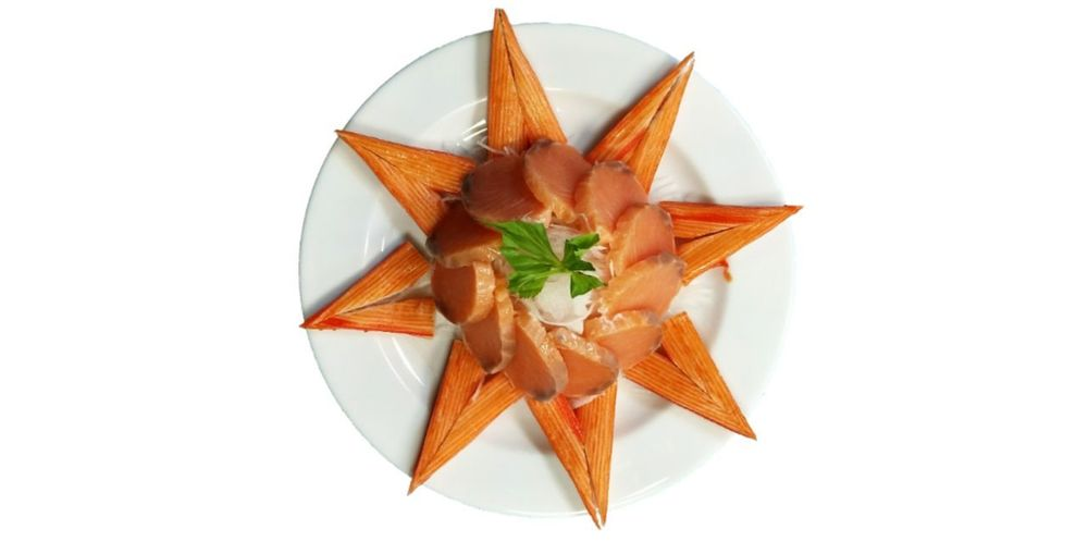 High angle view of orange in plate against white background