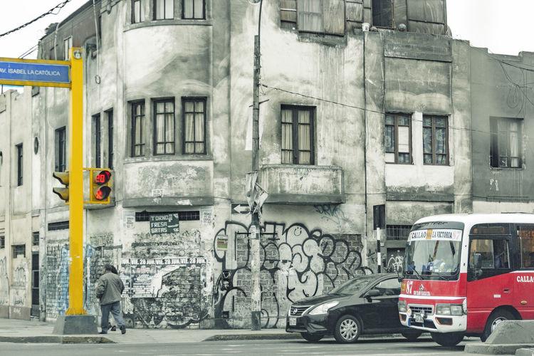Man on street against buildings in city