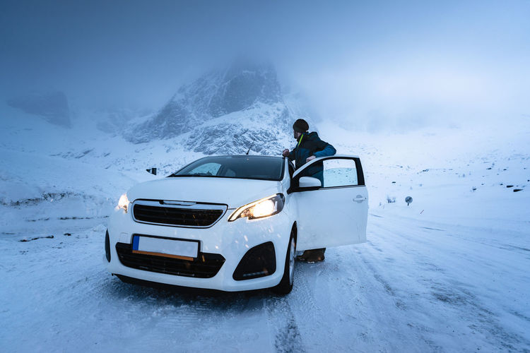 Car on snow covered mountain